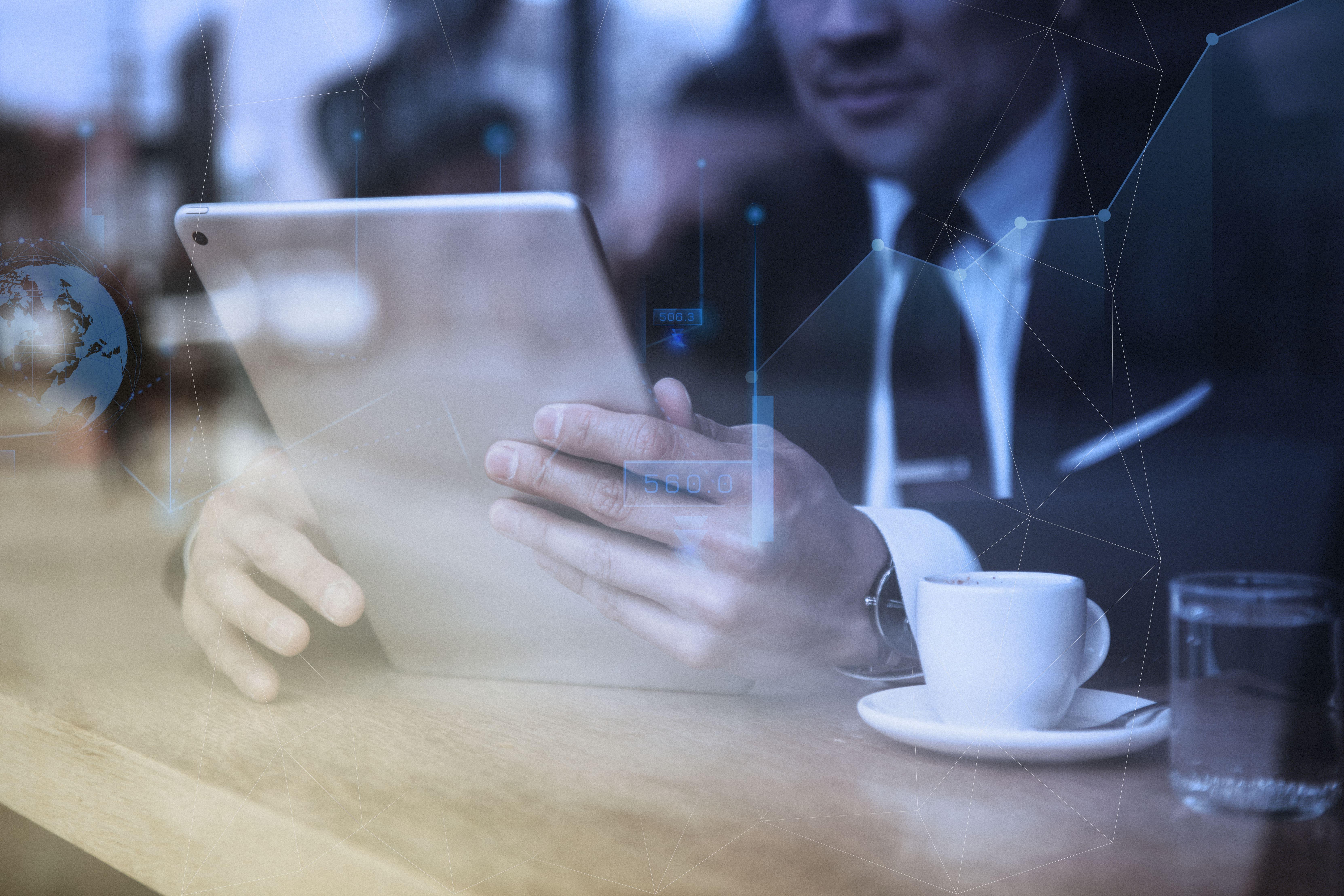 businessman-working-tablet-cafe-min