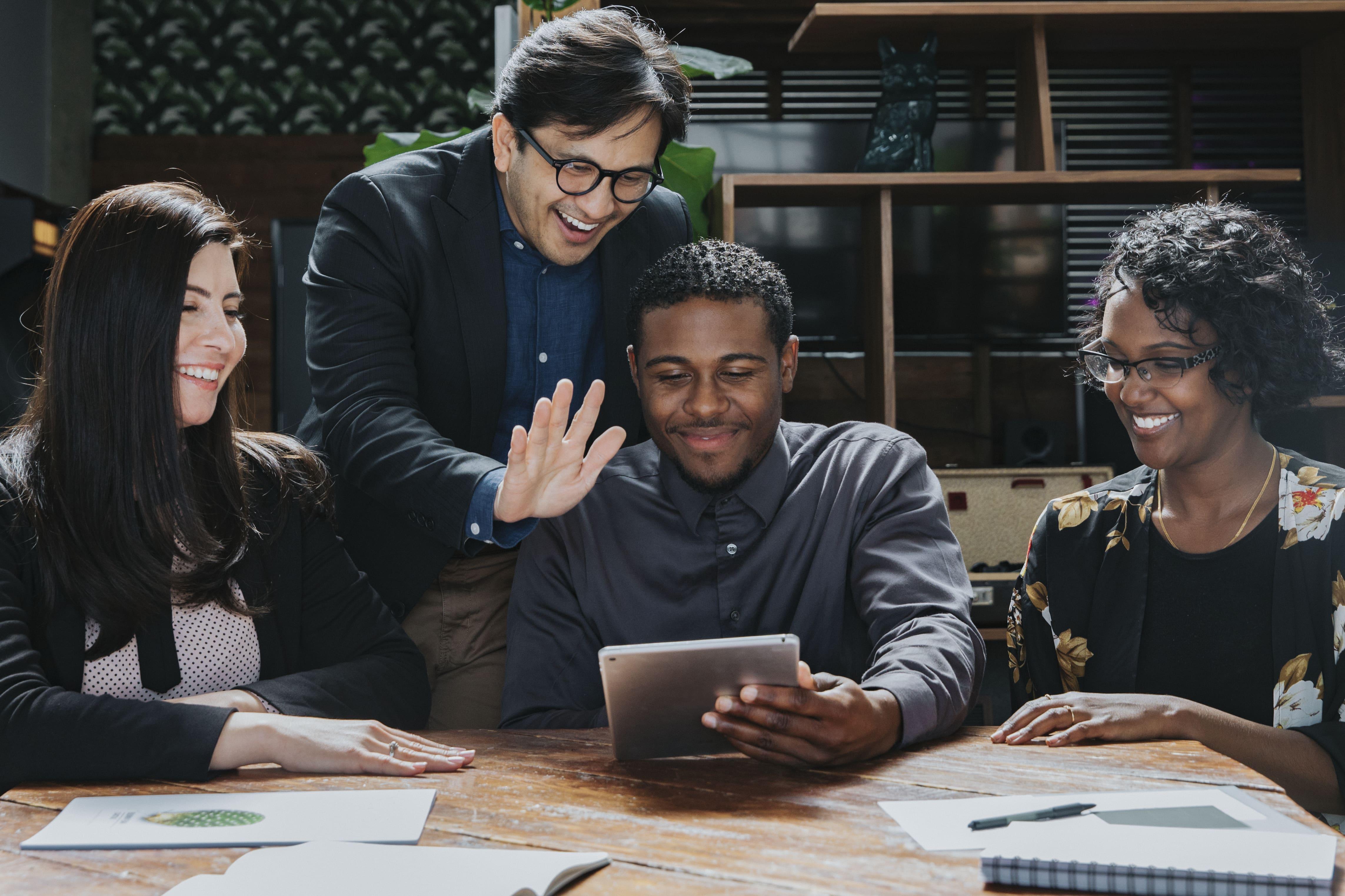 happy-businesspeople-meeting-room-min