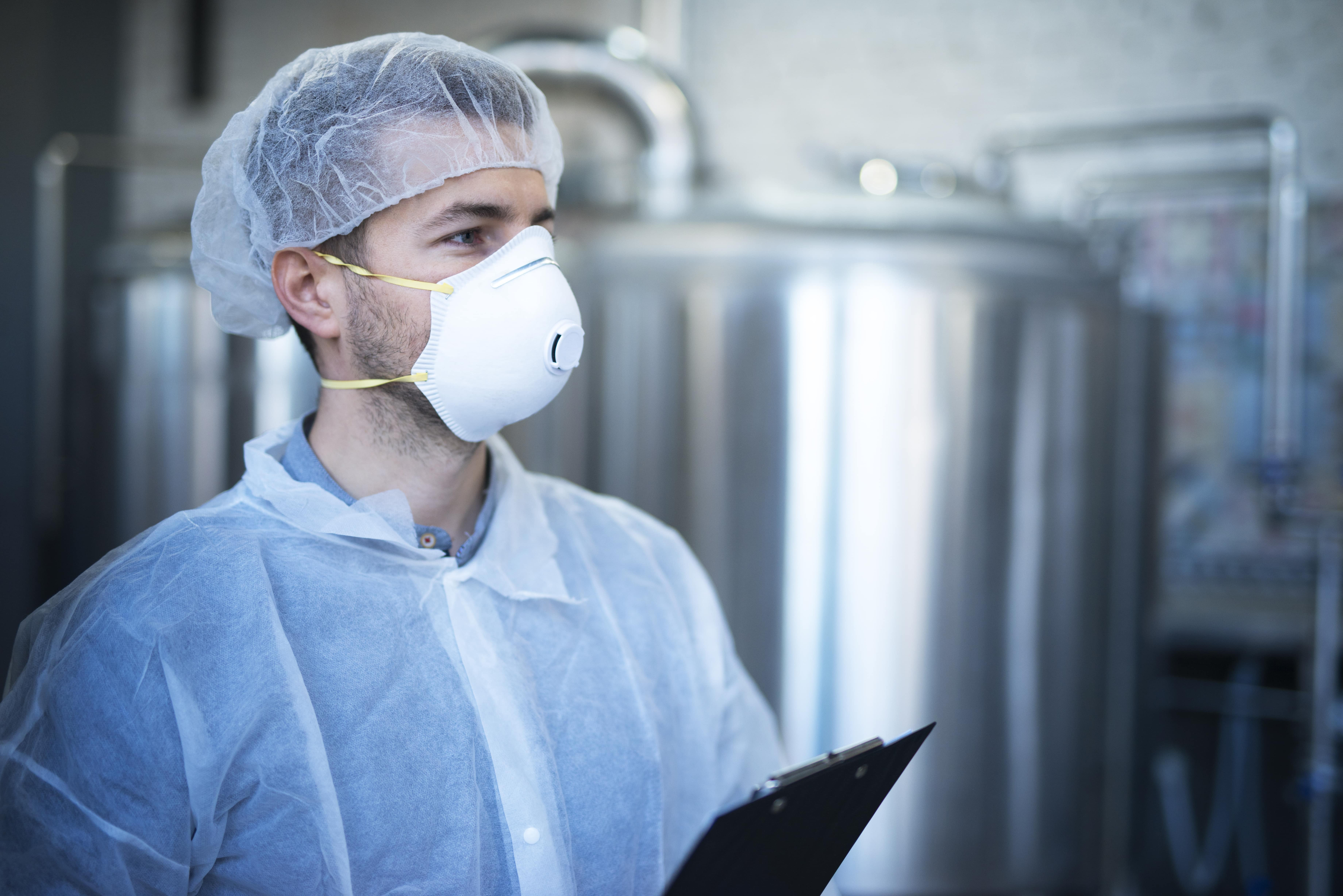 technologist-working-food-processing-factory-medical-production-checking-quality-distribution-min