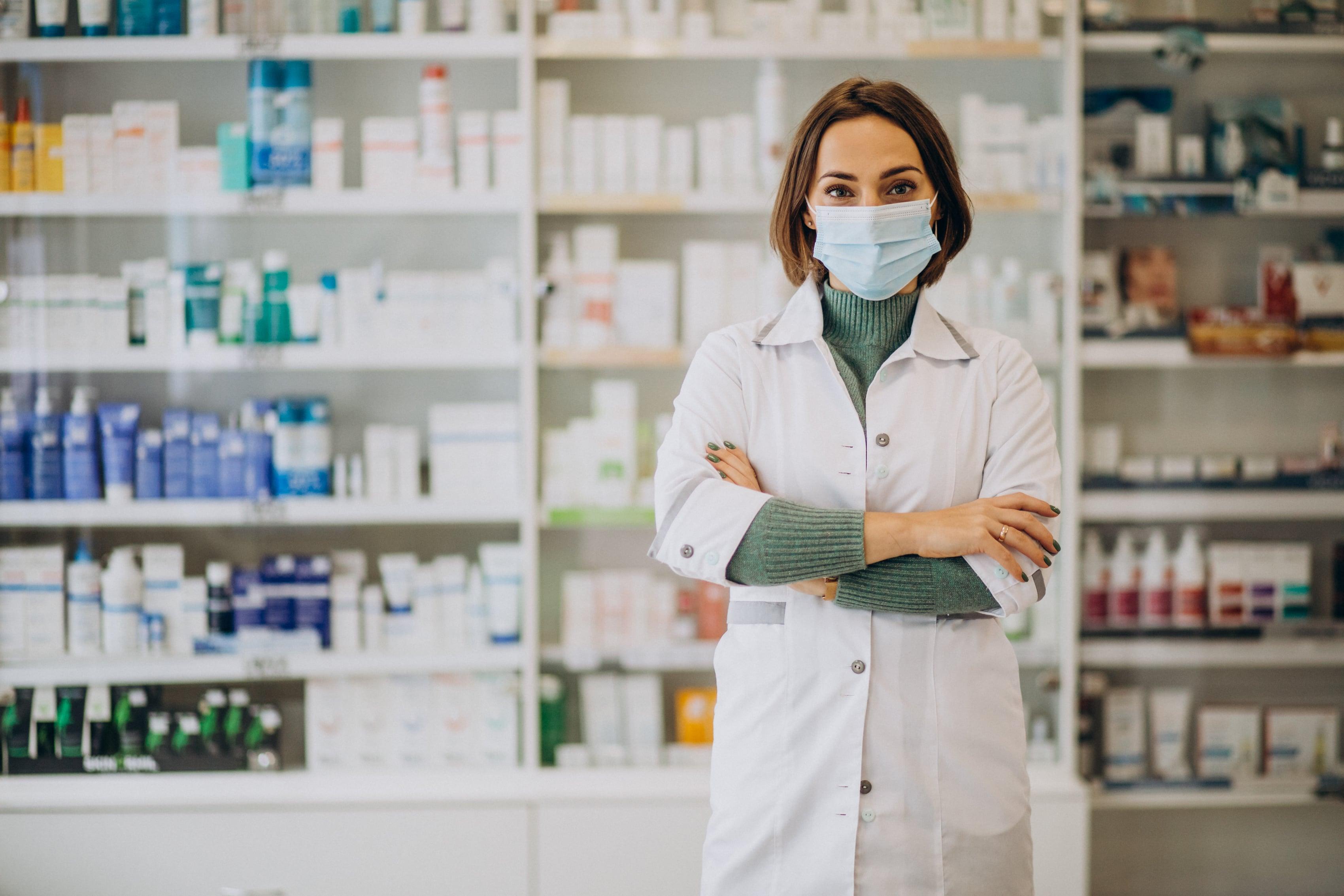 young-woman-pharmacist-pharmacy-min